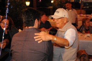 photo of Louie Perez Sr. with his hand on Raul Perez' back